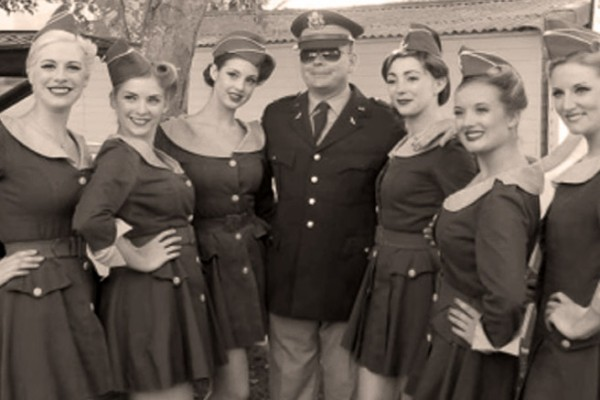 goodwood revival historic motorsport and aviation event sepia image, vintage uniforms, vintage glamour