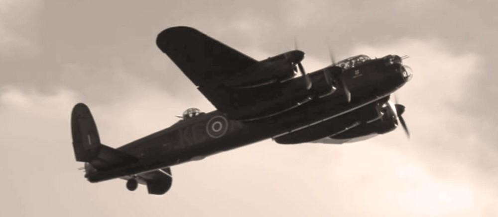 goodwood revival historic motorsport and aviation event sepia image, battle of britain memorial flight, lancaster bomber