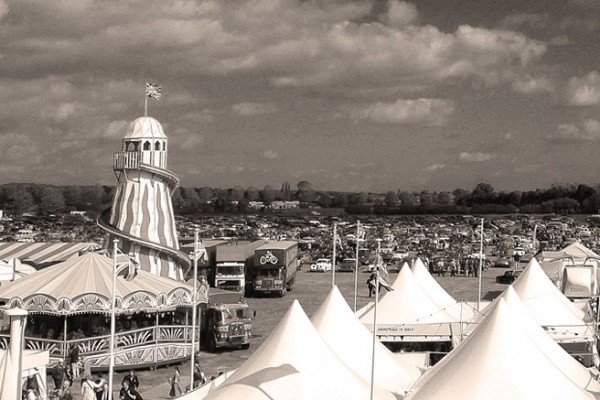 goodwood revival historic motorsport and aviation event sepia image, vintage funfair