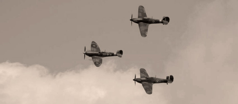 goodwood revival historic motorsport and aviation event sepia image, battle of britain memorial flight