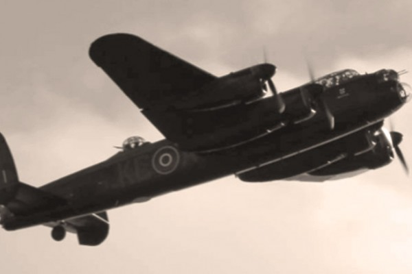 goodwood revival historic motorsport and aviation event sepia image, battle of britain memorial flight, lancaster bomber