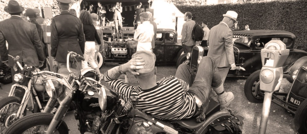goodwood revival historic motorsport and aviation event sepia image, vintage motorcycles