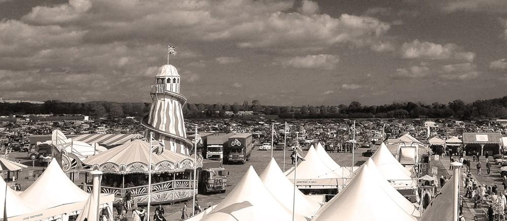 goodwood revival historic motorsport and aviation event sepia image, vintage funfair